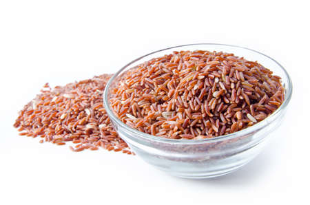 Photo pour Bowl of raw brown rice on white background - image libre de droit