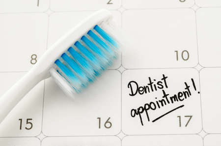 Photo for Reminder Dentist appointment in calendar with toothbrush. - Royalty Free Image