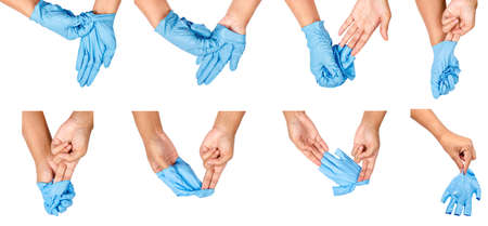 Foto de Step of hand throwing away blue disposable gloves medical, Isolated on white background. Infection control concept. - Imagen libre de derechos