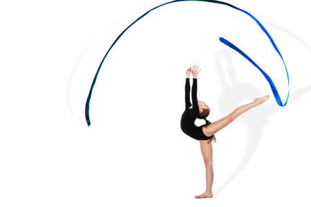 Foto de Yong gymnast performing exercise with ribbon on isolated background - Imagen libre de derechos