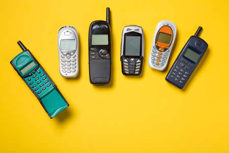 Photo for Old mobile phones on yellow background - Royalty Free Image