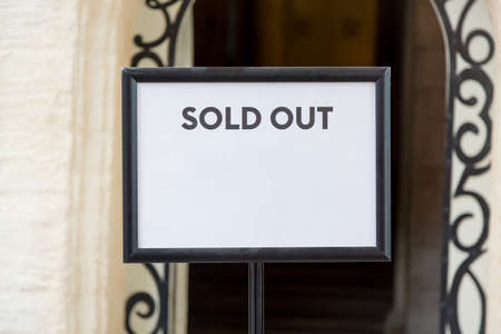 Foto de Sold out real estate or tickets sign before the entrance. Free space for your text - Imagen libre de derechos