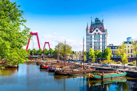 Photo for Rotterdam, South Holland, The Netherlands - May, 2018: Oude Haven harbor, Willemsbrug bridge, old ship yard dock, Ships, Openlucht Binnenvaart Museum during sunny summer day in Rotterdam - Royalty Free Image