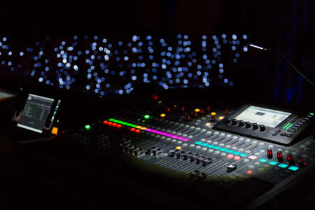 Photo pour Audio sound mixer console with buttons and sliders with lights at the concert. Selective focus. - image libre de droit