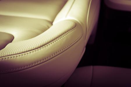 Foto de Part of  leather car seat with the unfocused car interior on the background, vintage filter - Imagen libre de derechos