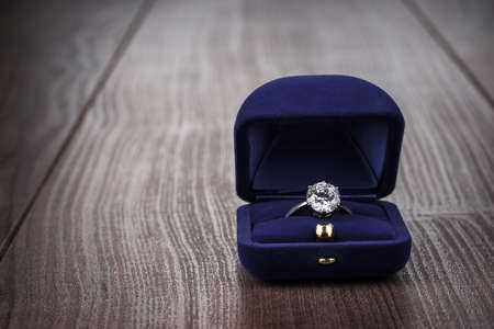 Photo for ring in the box on wooden table - Royalty Free Image