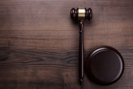Photo for judge gavel on the brown wooden background - Royalty Free Image