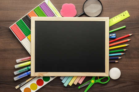 Photo for school supplies and blackboard with copy space on the table - Royalty Free Image