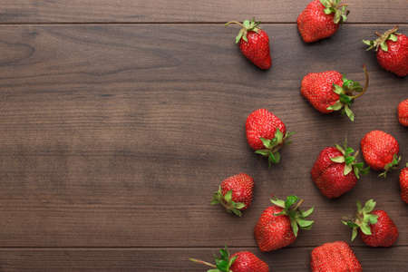 Photo for fresh strawberries on the brown wooden table - Royalty Free Image