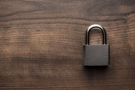 Foto de check-lock on the brown wooden table background - Imagen libre de derechos