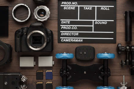 Photo pour different video making equipment for indie production on brown wooden table view from above. short movie production essentials - image libre de droit