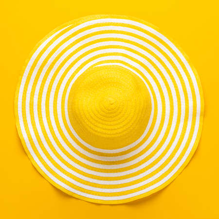 Foto de top view of yellow striped retro hat close-up. summer concept - Imagen libre de derechos