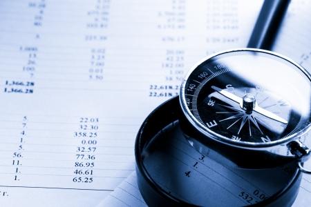 Photo pour Operating budget, magnifying glass and black compass - image libre de droit