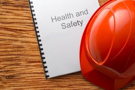 Photo pour Health and safety register with helmet in closeup - image libre de droit