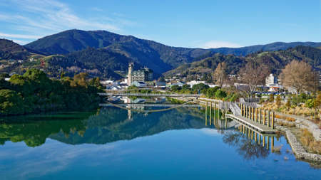 Photo pour Panorama of Nelson City, reflected in the still waters of the Maitai River, New Zealand. - image libre de droit
