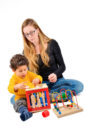 Foto de Mother and son are playing together as part of the creative children therapy - Imagen libre de derechos