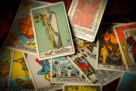 Photo pour A pile of tarot trump cards jumbled, scattered and haphazardly arranged. - image libre de droit
