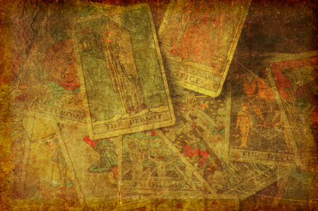 Foto de A textured, grunge background image of a group of scattered tarot cards from the major arcana. - Imagen libre de derechos