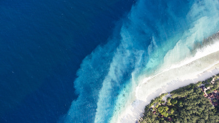 Photo for Top view aerial drone photo of one of the most beautiful beaches in the world, incredibly beautiful blue water makes a fascinating picture while ocean current carries the white sand seabed. Background - Royalty Free Image