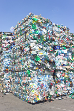 Photo for Stack of plastic bottles for recycling against blue sky - Royalty Free Image