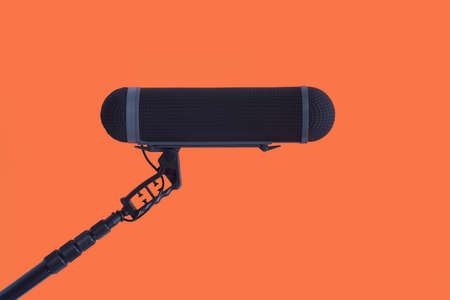 Photo for Sound recorder microphone, boom mic on red background - Royalty Free Image