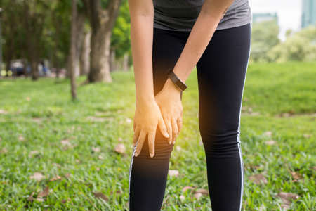 Photo pour Woman suffering from pain in leg and knee injury after sport exercise running jogging and workout outdoor - image libre de droit