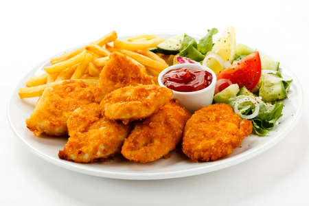 Foto per Close up of nuggets with french fries and salad - Immagine Royalty Free