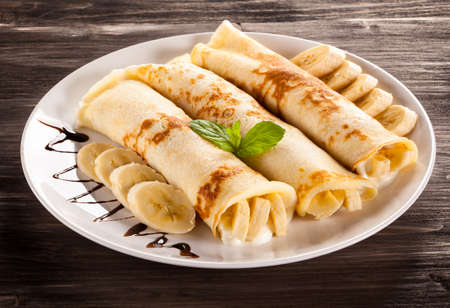 Photo for Crepes with bananas and cream - Royalty Free Image