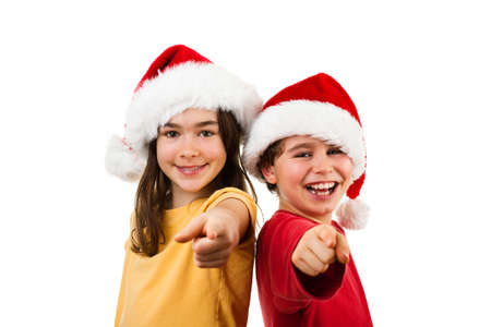 Photo for Christmas time - girl and boy with Santa Claus hat showing OK sign - Royalty Free Image