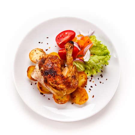 Foto de Roast chicken leg with chips on white background - Imagen libre de derechos