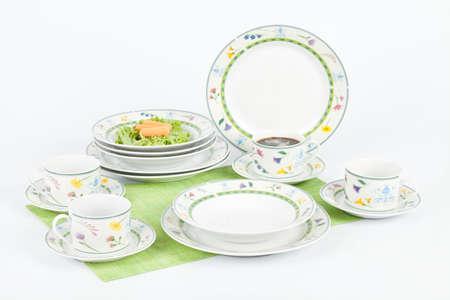 Foto de White Modern Dishes With Figures Flowers Shapes. - Imagen libre de derechos