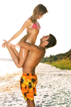 Photo pour Romantic couple having fun on the seaside - image libre de droit