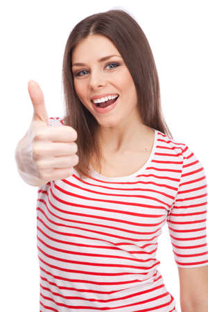 Young beautiful woman showing thumbs up