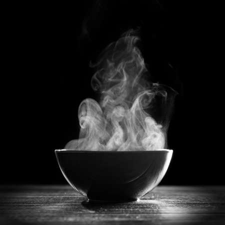 Photo for Bowl of hot soup on black background - Royalty Free Image