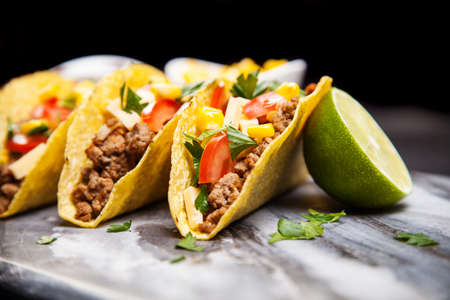 Foto de Mexican food - delicious tacos with ground beef - Imagen libre de derechos