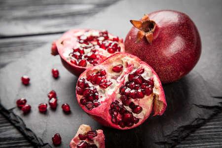 Photo pour Red juice pomegranate on dark background - image libre de droit