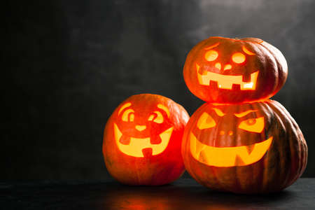 Photo for Three halloween Jack O Lantern pumpkins - Royalty Free Image