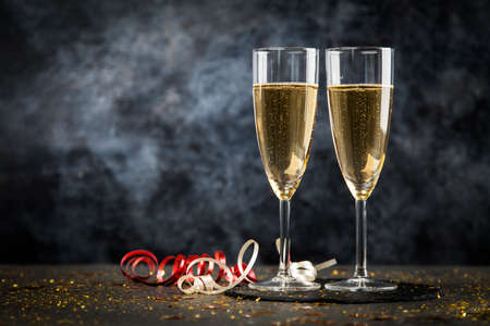Photo for Two champagne glasses in golden glitter - Royalty Free Image