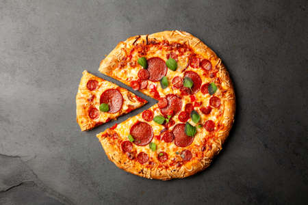 Photo for Pizza with salami and chorizo - Royalty Free Image