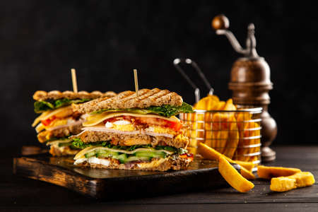 Photo for Tall club sandwich and french fries - Royalty Free Image