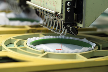 Foto de closed-up of Machine embroidery is an embroidery process whereby a sewing machine - Imagen libre de derechos