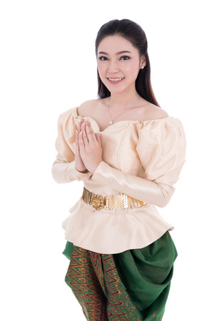 Photo for happy woman in Thai traditional dress is pay respect isolated on white background - Royalty Free Image