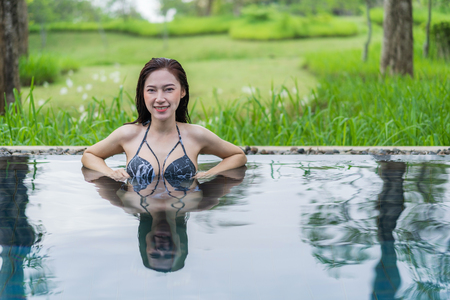 Photo for happy beautiful woman in the swimming pool  - Royalty Free Image