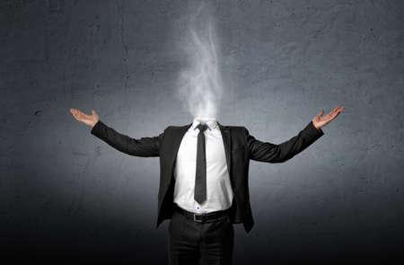 Foto de Smoke instead of a businessman head who raised his hands palm up. Front view - Imagen libre de derechos