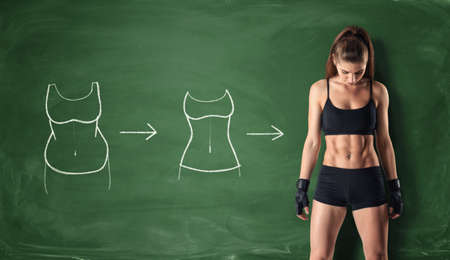Foto de Concept of how a girl's body changing - from fat belly to perfect waist and abs on the background of a chalkboard. Self-improvement and sport. Athletic body. Workout and fitness. - Imagen libre de derechos