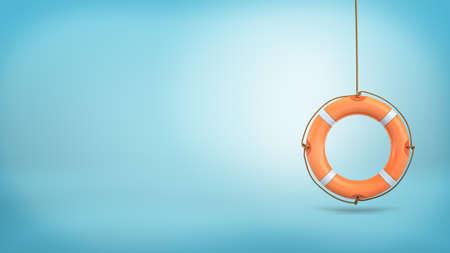 Foto de 3d rendering of a single orange life buoy hangs down from a rope on a blue background. - Imagen libre de derechos