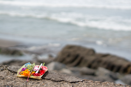 Photo for Balinese Offering on Batu Bolong Beach in Canggu with the Waves of the Ocean in the Background - Royalty Free Image
