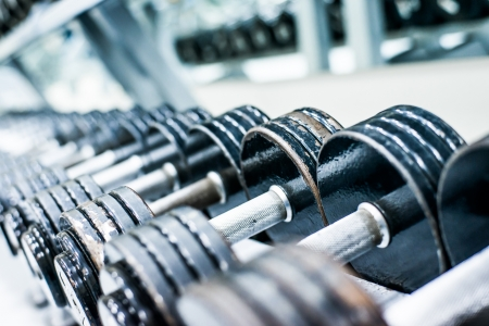 Foto de Sports dumbbells in modern sports club  Weight Training Equipment - Imagen libre de derechos