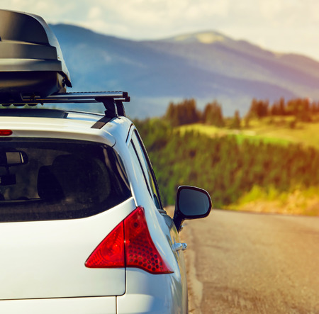 Foto für car for traveling with a roof rack on a mountain road - Lizenzfreies Bild