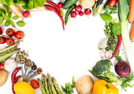 Photo pour Vegetables in heart shape on a white background - image libre de droit